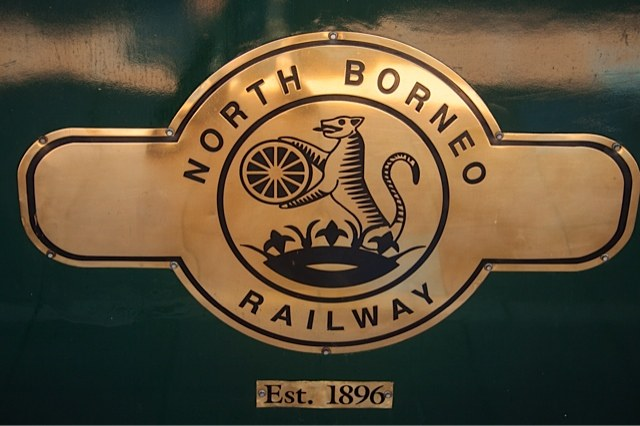 Brass logo on the carriage