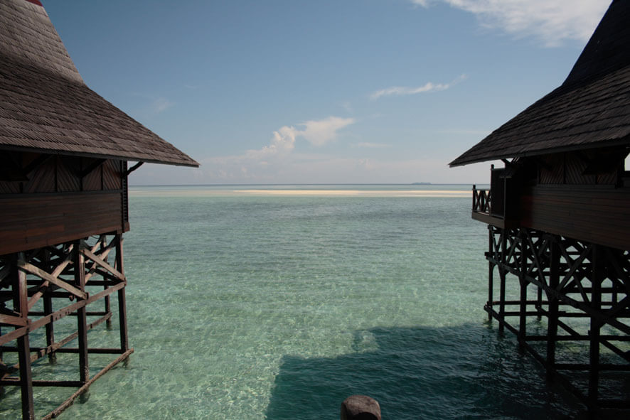 Sipadan Island as seen from Kapalai (on the horizon, just to the left of the eave on the right hand side)