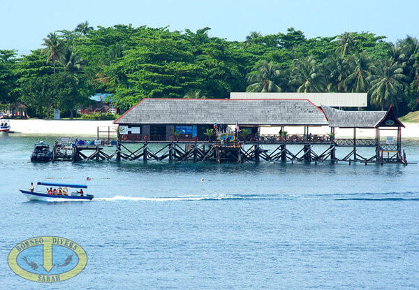 Speedboats ferry divers to the sites from the Borneo Divers Mabul Resort Dive Centre